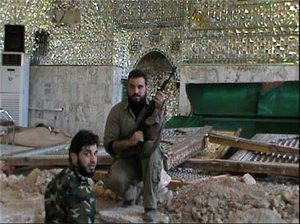 Tentara-Wahabi-di-atas-puing-makam-Hujr-ibn-Adi